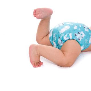Couche lavable Te1 de la marque Bamboolik portée par un bébé